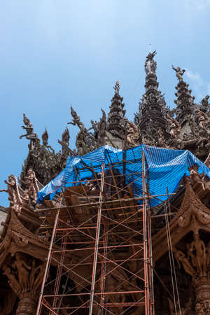 Low angle view of restoration site on the side exterior of the Sanctuary of Truth, Thailand