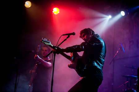 indie: Rock band performing live in a club  Editorial