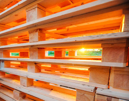 Sun shining throuh wooden pallets photo