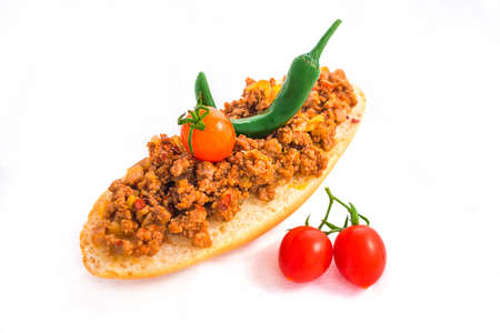 Sandwich with minced meat mexican style with vegetables isolated on white