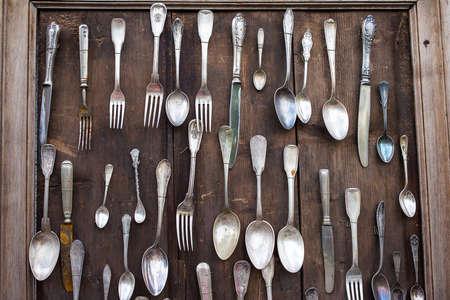 utencils: Decorative utencils on wooden board Stock Photo
