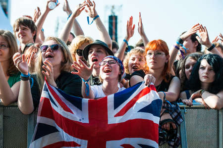 indie: Music fans with british flag on a concert