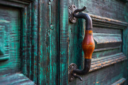 Old door with handle and lock photo
