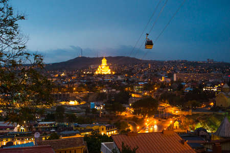 View of Tbilisi Old town  with Sameba church at night Stock Photo