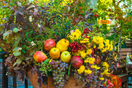 Autumn bouquet of flowers and fruits Stock Photo