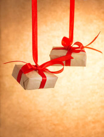 Gift boxes on old paper background photo