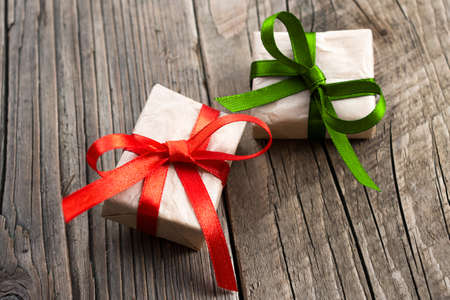 Gift boxes on old wooden background Stock Photo