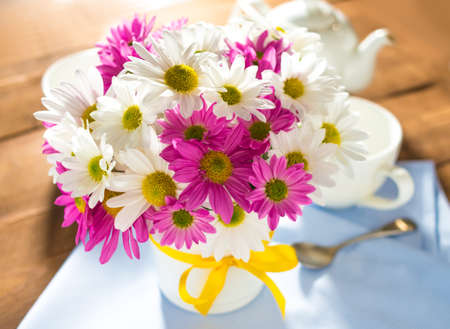 big daisy: Bouquet of pink and white chrysanths on wooden background