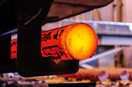 Hot steel blanks coming out of furnace Stock Photo - 24043088