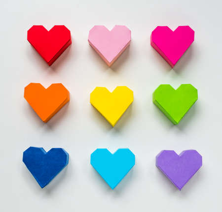 Paper hearts on white background photo