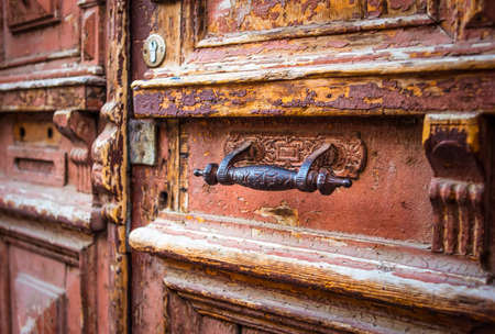 Wooden door with iron handle and mailbox hole Stock Photo