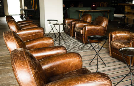Classic brown leather armchairs in lobby