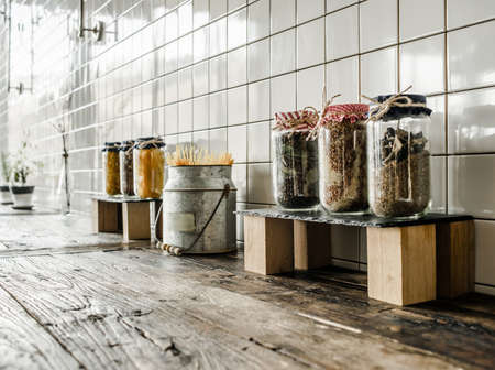 kitchen tile: Cans with different grocery items on wooden kitchen table