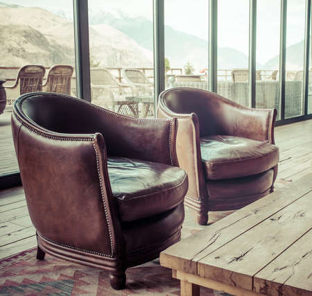 leather sofa: Two classic brown  leather armchairs. Picture toned in retro style Stock Photo