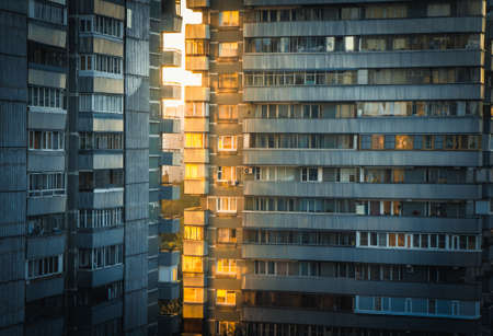 partment: Sun shining through apartment buildings  at sunset on the outskirts of Moscow, Russia Editorial