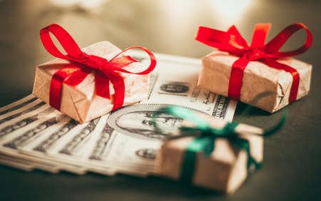 christmas budget: Gift boxes and US dollar bills. Toned picture