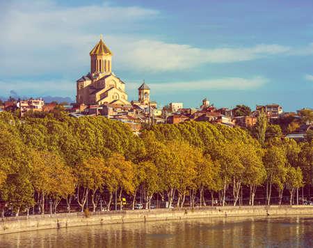 sacred trinity: View of Sameba church and Kura river in Tbilisi, Georgia. Toned picture Stock Photo