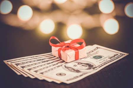 Gift box and US dollar bills. Toned picture photo