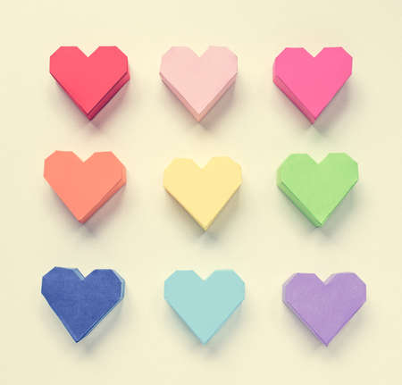Paper hearts on white background. Toned picture photo