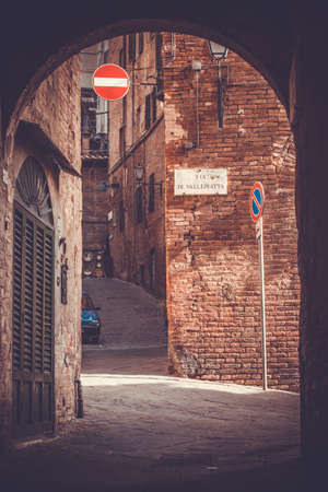 Beautiful street view in Siena, Italy. Toned picture photo