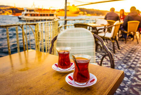 seaview: ISTANBUL, TURKEY -  october 23, 2014: people are drinking tea in a cafe with Bosphorus bridge view  in Istanbul, Turkey. Toned image. Editorial