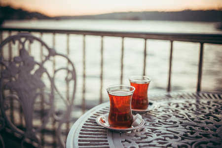 Turkish tea is served in a cafe with Bosphorus view in Istanbul, Turkey.