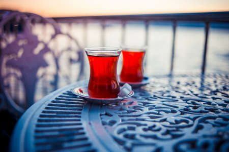 istanbul: Turkish tea is served in a cafe with Bosphorus view in Istanbul, Turkey.
