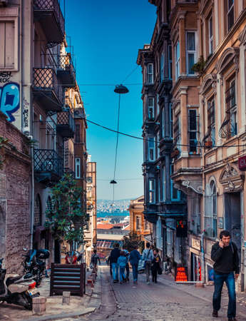ISTANBUL, TURKEY -  october 26, 2014: People are walking down the streets of Beyoglu in Istanbul, Turkey.