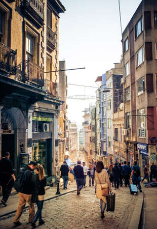turkish people: ISTANBUL, TURKEY -  october 26, 2014: People are walking down the streets of Beyoglu in Istanbul, Turkey.