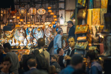 grand sale: ISTANBUL, TURKEY -  october 26, 2014: Vendors are selling lanterns and pottery at Grand Bazaar in Istanbul, Turkey. Editorial
