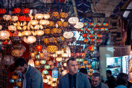 turkish people: ISTANBUL, TURKEY -  october 26, 2014: Vendors are selling lanterns and souvenirs at Grand Bazaar in Istanbul, Turkey.