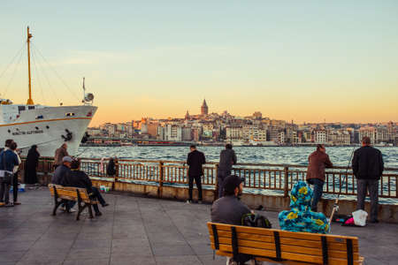 eminonu: ISTANBUL, TURKEY -  october 26, 2014: People are walking at Eminonu pier in Istanbul, Turkey.