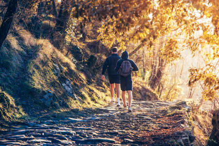 hiking shoes: Two men running in forest