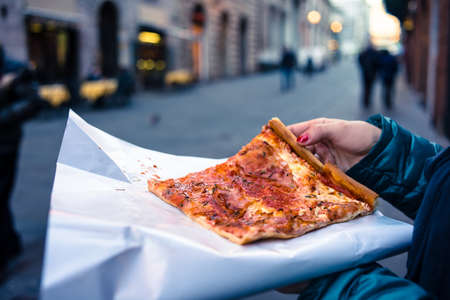 culinary tourism: Freshly baked traditional savoury Italian pizza as a street food