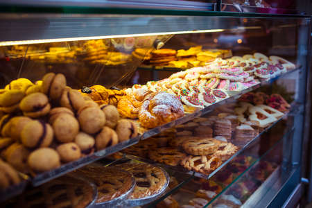 Various pastry type on shelf in bakery shop Stok Fotoğraf