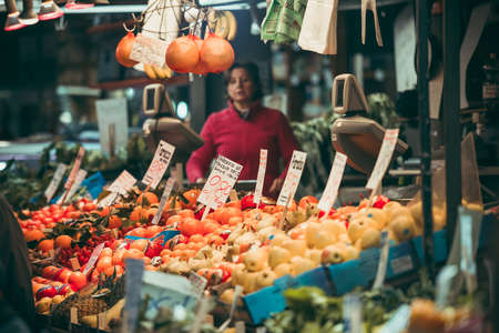 GENOA, ITALY - FEBRUARY 23, 2015: Fresh fruits and vegetables for sale in Mercato Orientale, famous market in central GenoaÑŽ Toned image