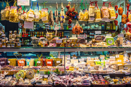 GENOA, ITALY - FEBRUARY 23, 2015: Various cheese and other quality Italian products for sale in Mercato Orientale, famous market in central Genoa
