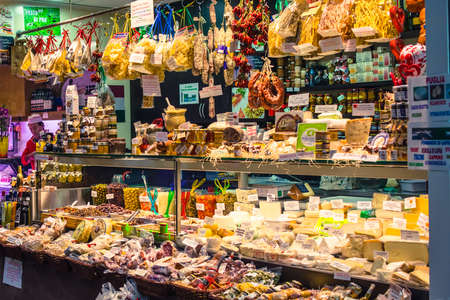 butcher's shop: GENOA, ITALY - FEBRUARY 23, 2015: Various cheese and other quality Italian products for sale in Mercato Orientale, famous market in central Genoa