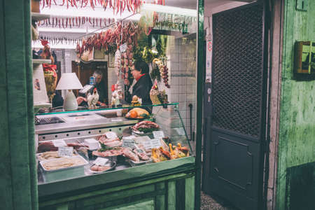 local 27: GENOA, ITALY - FEBRUARY 27, 2015: Store selling typical Italian gourmet delicacies and local specialties like cheese and meat. Toned picture