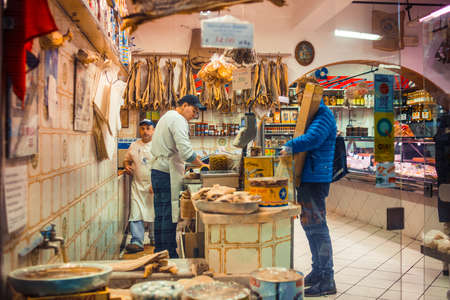 fish shop: GENOA, ITALY - FEBRUARY 27, 2015: Store selling typical Italian fish gourmet delicacies and types of fish