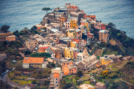 Corniglia is one of five famous colorful villages of Cinque Terre in Italy photo