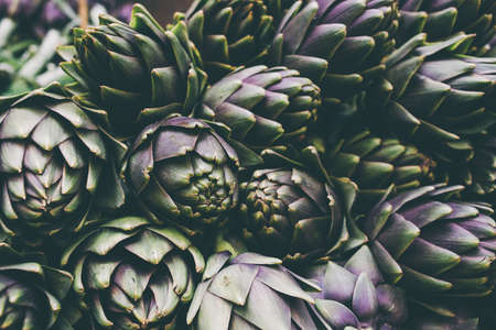 health food store: Artichokes on farmer market in Italy. Toned image