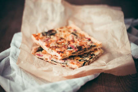 custard slices: Two slices of quiche or pizza or focaccia on craft paper