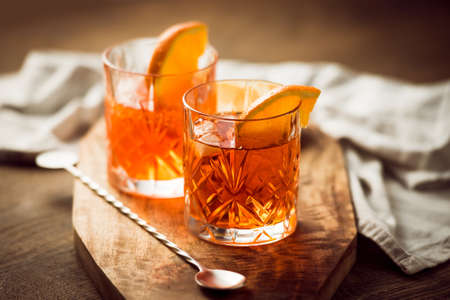 drink: Two glasses of cocktail with orange slice Stock Photo