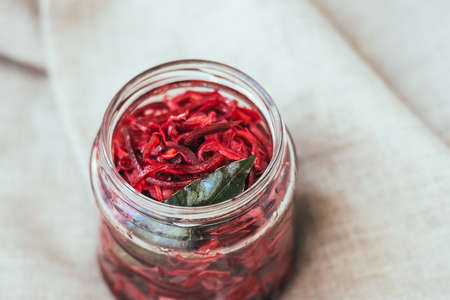 bay leaf: Pickled cabbage with beetroot and bay leaf in a small jar Stock Photo