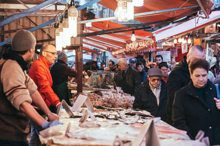 fish shop: PALERMO, ITALY - MARCH 13, 2015: Seafood and fish shop at famous local market Ballaro in Palermo, Italy