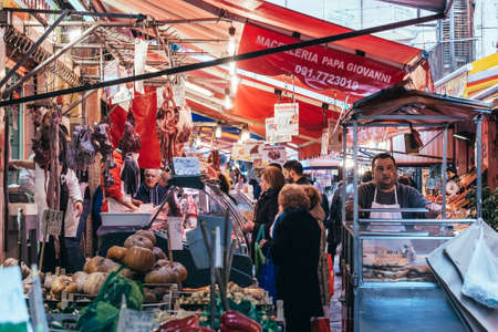 PALERMO, ITALY - MARCH 13, 2015: Butcher sells meat at famous local market Ballaro in Palermo, Italy