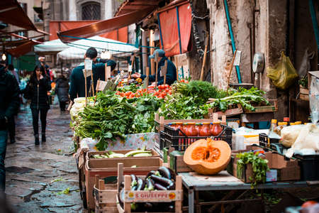 palermo: PALERMO, ITALY - MARCH 13, 2015:  Grocery shop at famous local market Ballaro in Palermo, Italy