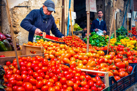 market vendor: PALERMO, ITALY - MARCH 13, 2015:  Grocery shop at famous local market Ballaro in Palermo, Italy