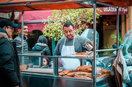street food: PALERMO, ITALY - MARCH 13, 2015: Street food vendor at famous local market Ballaro in Palermo, Italy Editorial